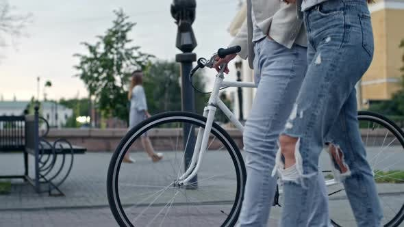 Cover Image for Boyfriend and Girlfriend Walking with Bicycle