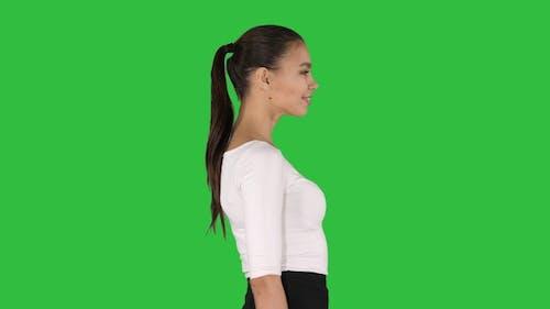 Beautiful and elegant hispanic business woman walking and