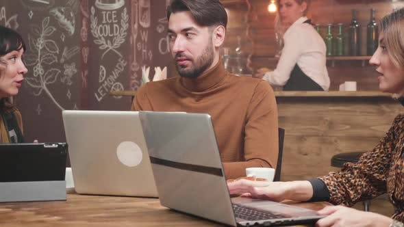 Thumbnail for Young Freelance Entrepreneur Receiving Advice From His Female Colleagues