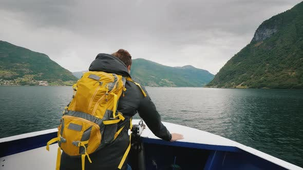 Thumbnail for Traveler Admires the Beautiful View From the Bow of a Cruise Ship. Fjord Cruise in Norway