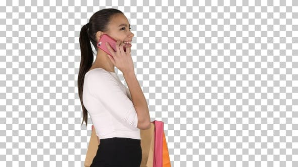 Thumbnail for Young Woman Walking with Shopping Bags Talking on Mobile Phone