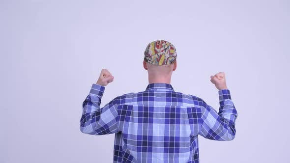 Thumbnail for Rear View of Happy Young Hipster Man with Fists Raised