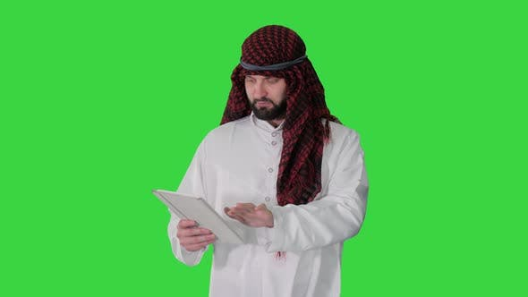 Thumbnail for Sheikh Using Digital Tablet and Walking on a Green Screen, Chroma Key.
