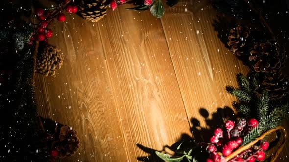 Falling snow with Christmas holly decoration