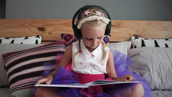 Thumbnail for Girl is listening music and reading