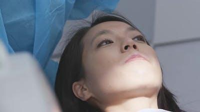 Woman having dental check up at dental clinic