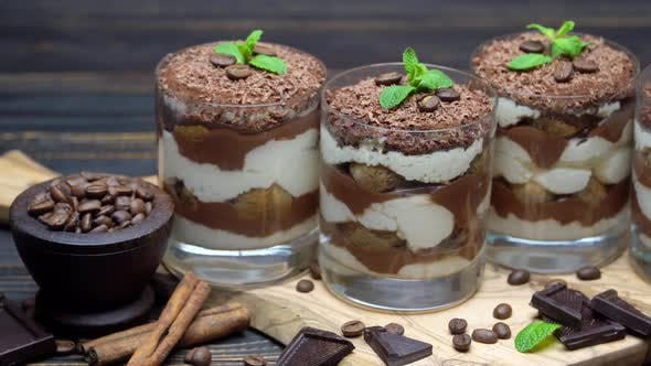 Thumbnail for Classic Tiramisu Dessert in a Glass on Wooden Background