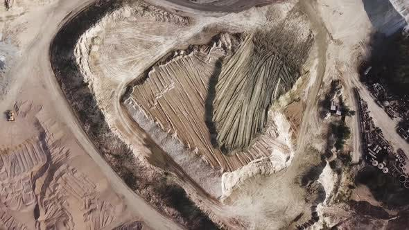 Aerial top view of quarry during work hours