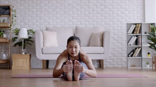 Asian woman pilates exercise yoga at home.