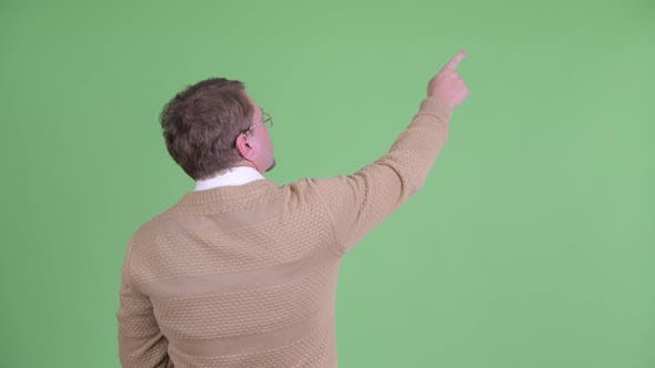 Cover Image for Rear View of Overweight Bearded Man Pointing Finger and Directing