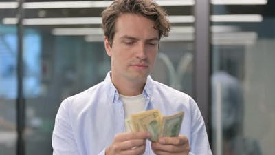 Portrait of Man Counting Dollars