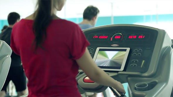 Thumbnail for Woman Runs on Treadmill