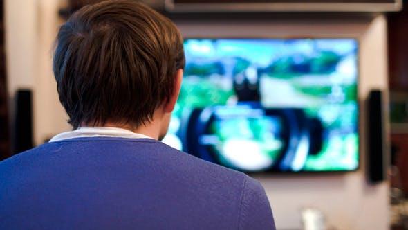 Man Playing Shooter Video Game