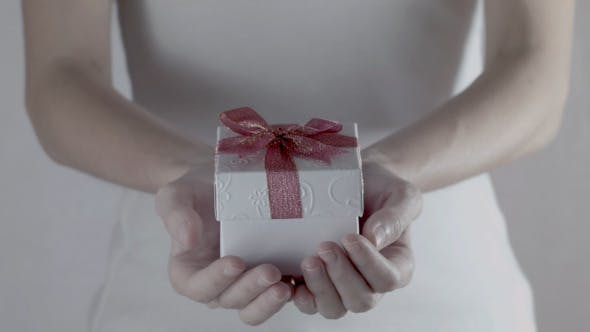 Thumbnail for Hands With White Gift Box
