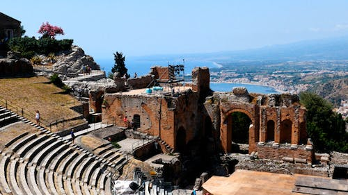 People In An Ancient Amphitheater