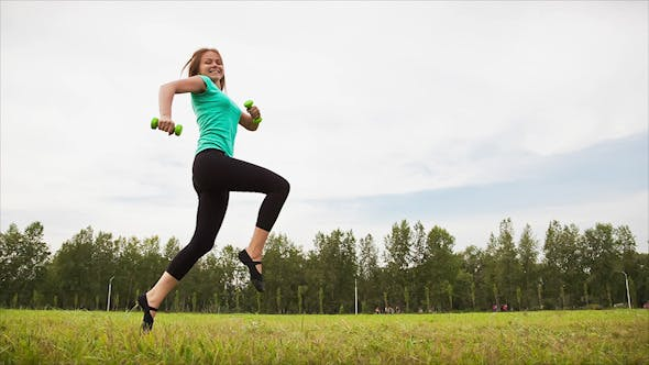 Thumbnail for Woman With Dumbbells in a Meadow 4