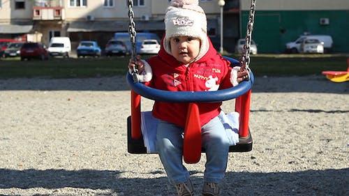 Baby in Neighbourhood Swing