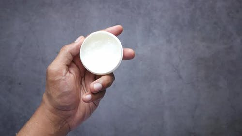 Close Up of Man Hand Using Petroleum Jelly
