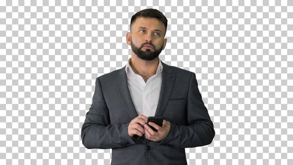 Business man thinking and using the phone, Alpha Channel
