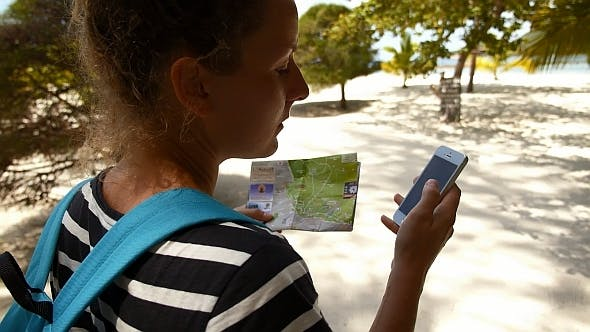 Thumbnail for Tourist Woman With Map and Smartphone