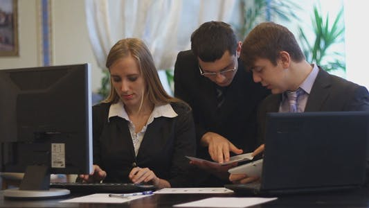 Thumbnail for Business People Working at a Computer