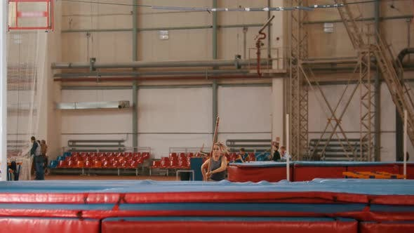 Thumbnail for Pole Vaulting - Young Sportswoman Is Running and Jumping Over the Bar