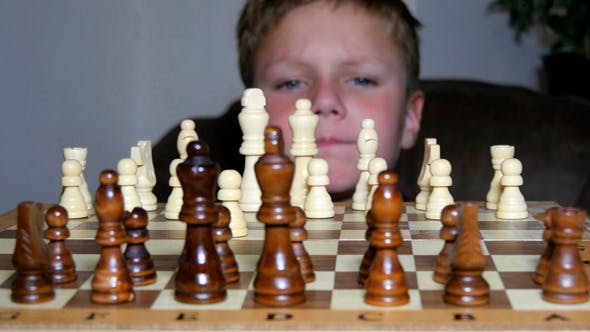 Thumbnail for Little Boy Fascinated By The Game Of Chess
