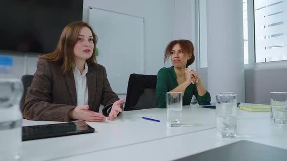 Business Women Having Meeting in Office