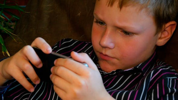 Thumbnail for Child Playing With Smartphone