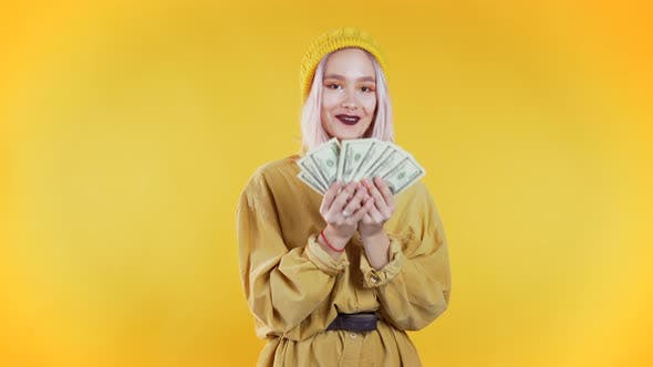 Thumbnail for Satisfied Happy Excited Unusual Teen Girl Showing Money - U.S. Currency Dollars