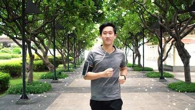 Man Jogging on Footpath at Park