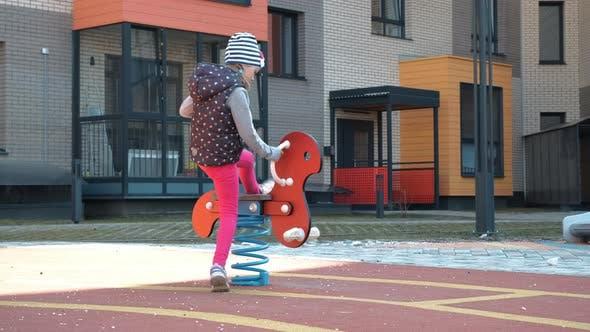 Cute Little Girl Having Fun on a Playground