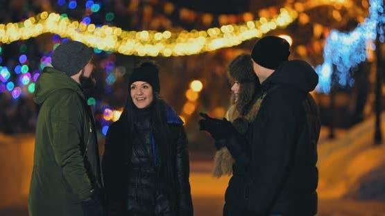 Friends Talk on the Street in Winter