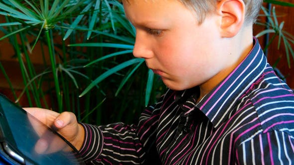 Thumbnail for Boy Playing On The Tablet Computer Games