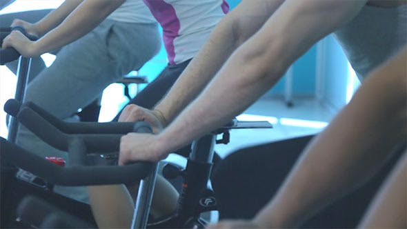 People Doing Exercise on the Exercise Bike