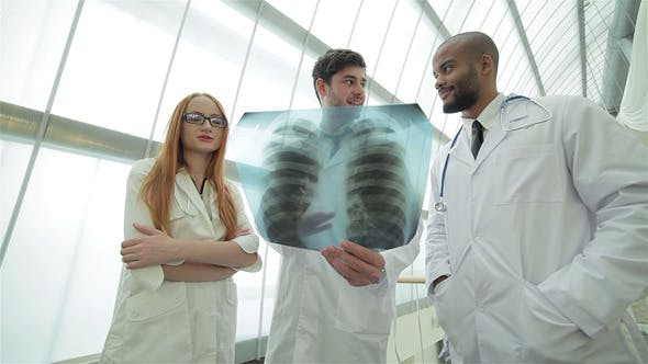 Thumbnail for Three Confident Doctor Examining X-ray Snapshot