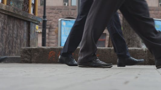 Thumbnail for People Walk Through The City