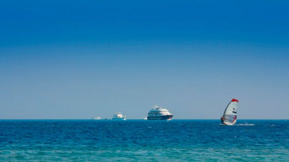 Thumbnail for Yachts And Surfers On Turquoise Sea