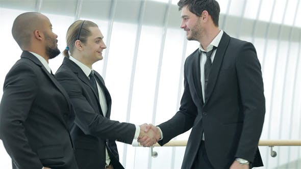 Two Successful Smiling Businessmen Shaking Hands by kotlyarn on Envato  Elements
