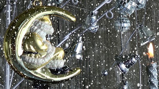 Thumbnail for Santa Claus Ornament and Candle Under Snow Fall