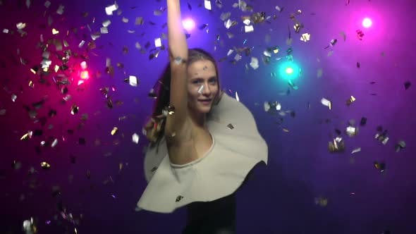 Cover Image for Close-up Girl Throws Glitter Confetti and Dancing. Slow Motion