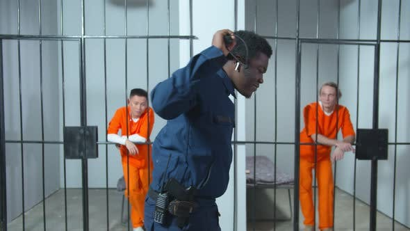 Thumbnail for Prison Guard Listens To Music Through Headphones and Dances