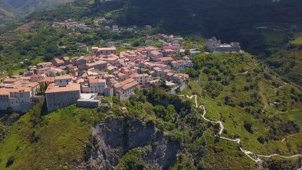 Cover Image for Aerial View of Medieval City on Hill Overlooking the Sea Coast Village and Mountains, Tiled Roofs