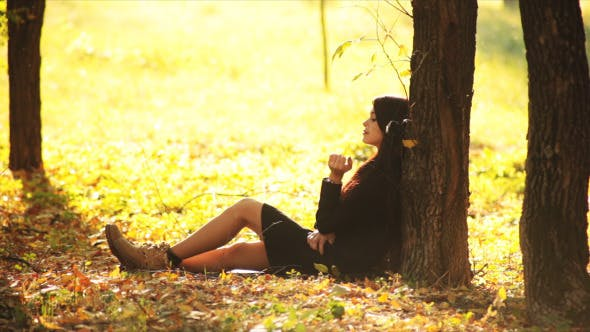 Thumbnail for Girl Dreams Under Tree In Autumn Park