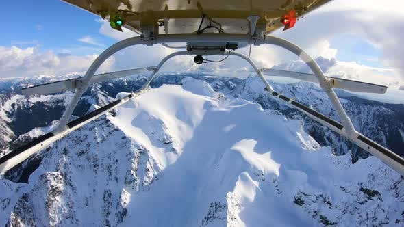Thumbnail for Winter Expedition Deep Into Mountainous Backcountry Flying Helicopter Reverse Skids View