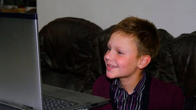 Boy Communicates By Webcam