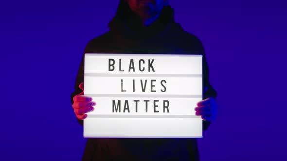 Man Holds a Political Sign Black Lives Matter