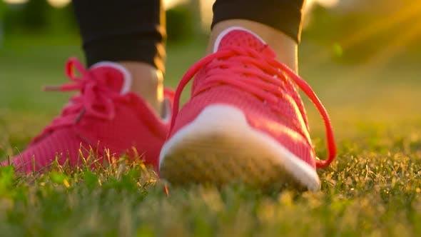 Running Shoes  Woman Tying Shoe Laces