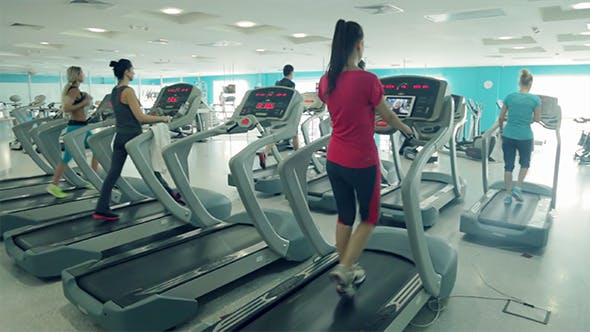 Cover Image for Running on Treadmill in the Fitness Club