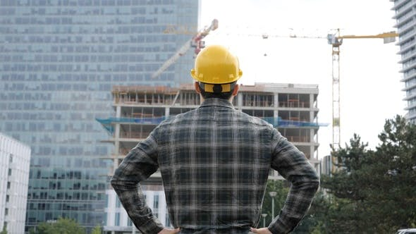 Thumbnail for Architect Looking on Construction Process on A Sunny Day.